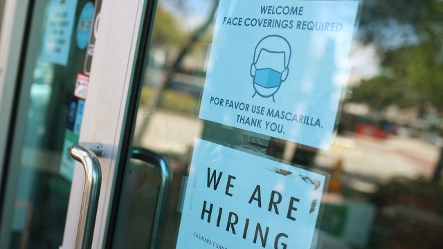 A store in Miami announces job openings on March 5, 2021. Despite recent job gains, U.S. employment in February 2021 was 8.5 million less than in February 2020. (Joe Raedle/Getty Images, via Pew Research Center)